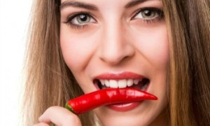 FIwoman-biting-chili-pepper
