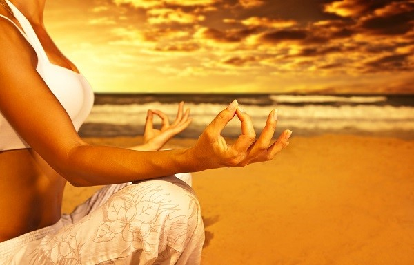Yoga meditation on the beach