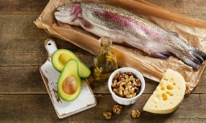 53650534 - foods highest in fat on a rustic wooden background. top view