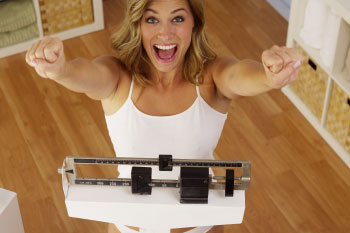woman-on-scale-success