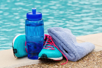 gym shoes water bottle by pool