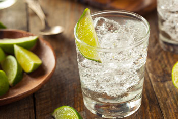 water with lime on wood table