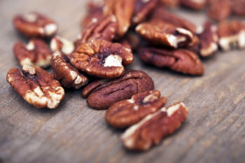 Pecans on a wood table