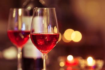 2 glasses red wine in fancy restaurant