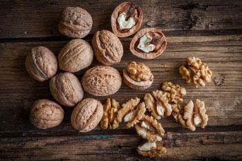 Opened Walnuts on Wood Table