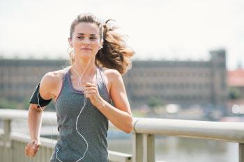 woman running on pier