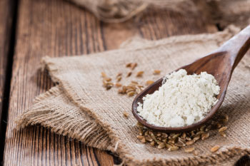 sprouted flour on a wooden spoon