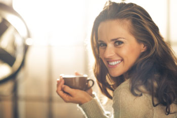 girl smiling holding hot chocolate raw cacao skyrockets health