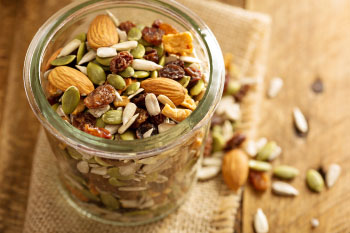 trail mix in a glass jar never throw pumpkin seeds away
