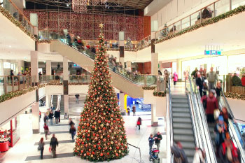 christmas tree in a mall overcome loneliness holidays