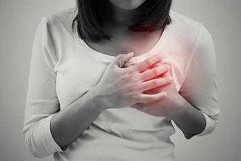 woman having a heart pain stress affects body