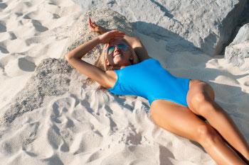 woman sunbathing release feel good hormones endorphins