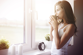 woman having a morning coffee positive mindset