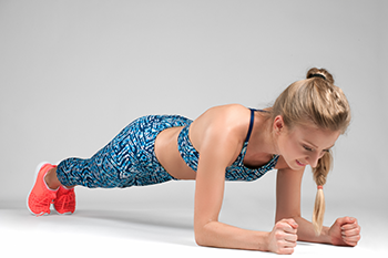 sports woman planking prevent back pain