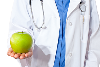 doctor holds green apple boost energy