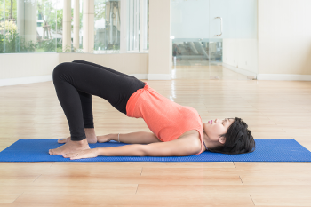 asian woman yoga bridge pose kegel exercises important