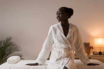 black woman wearing comfortable robe home spa