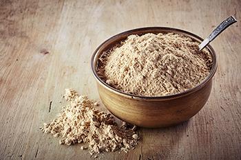 bowl of maca root powder superfoods 2018