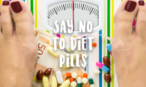 diet pills on weighing scale