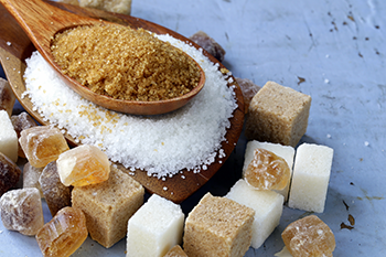 brown white refined sugar table natural remedies menstrual cramps