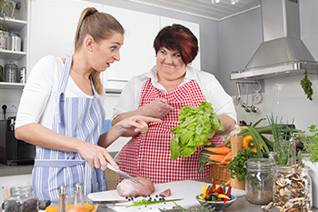 mother daughter making salad kitchen avoid weight loss mistakes