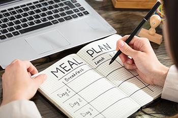 businesswoman write meal plan notebook brain weight loss hack