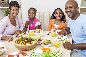african american family eat fruits vegetables numbers track health