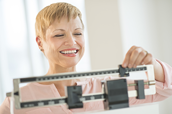 happy woman benefits losing 5% body weight