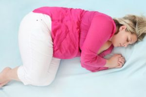 woman sleeping on bed winter weight gain