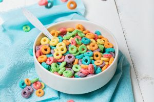 bowl of colorful cereal on teal towel