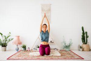 girl doing yoga in house