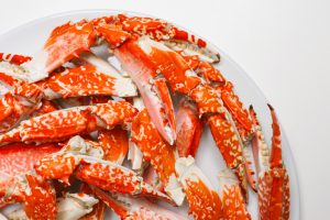 bowl of crab legs on white table