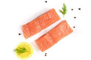 raw salmon on white table