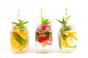 3 mason jars filled with fruit in bubble water