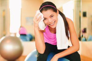 woman sweating at gym