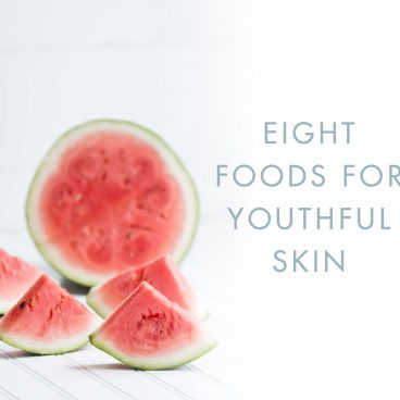 foods for youthful skin watermelon on white wood table