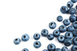 blueberries on white table