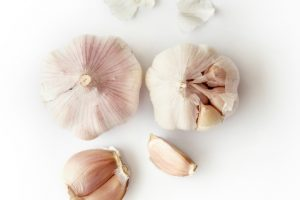 garlic on white table probiotics weight loss