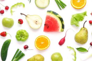 various fruits and vegetables on white background